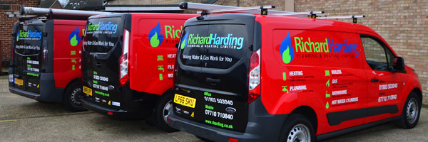 Richard Harding Plumbing and Heating - our distinctive red and black vans serving the Worthing region