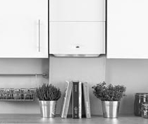 A wall-mounted central heating boiler integrated into a run of kitchen units